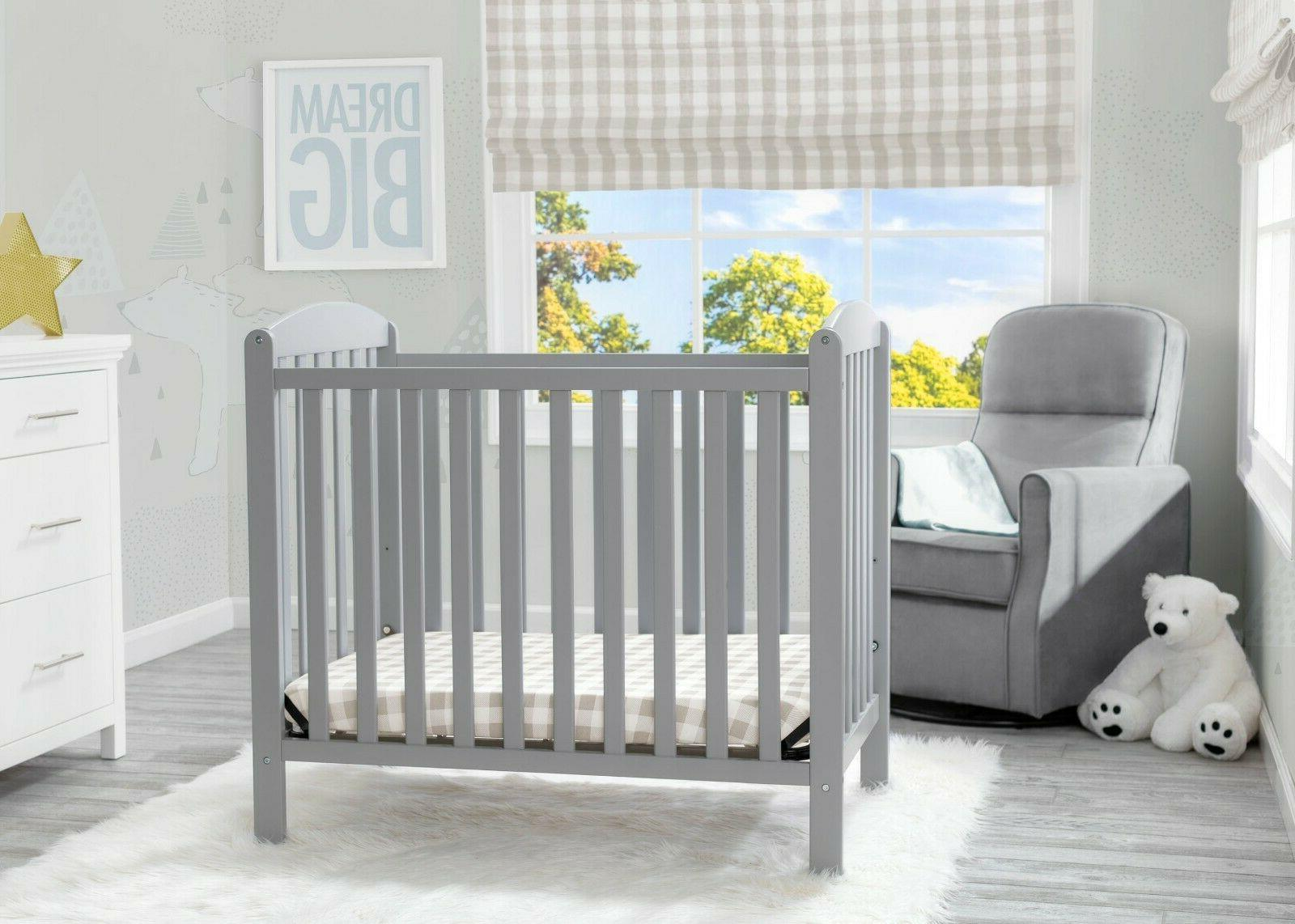 Delta Children Mini Convertible Baby Crib with Mattress